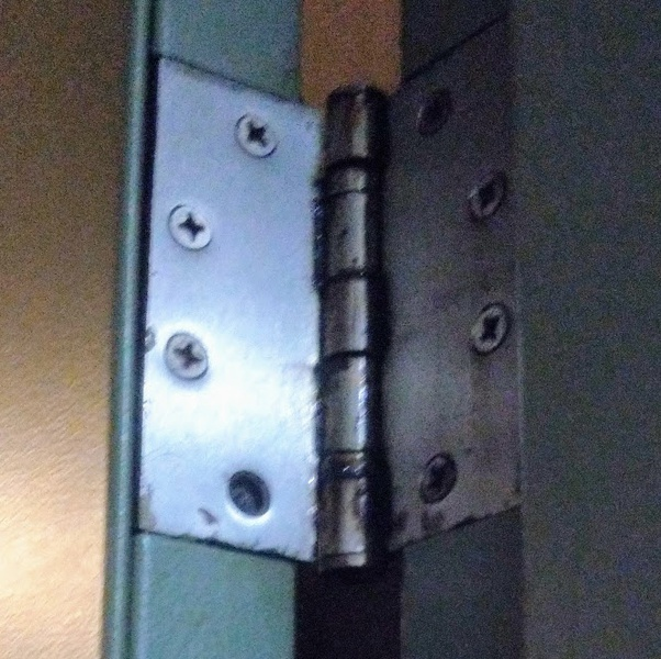how to fix a stripped screw hole in metal door-1